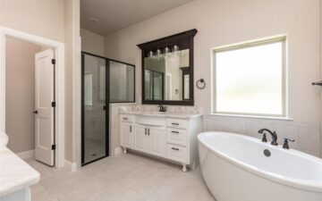 photo of the interior bathroom of a home showing a shower, sink, and bathtub