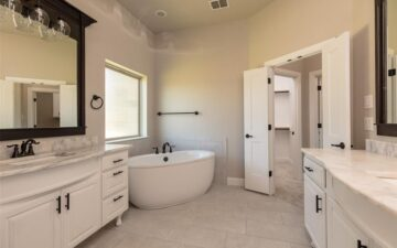 photo of a bathroom interior of a home for sale showing a sink and bathtub