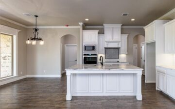 photo of a kitchen showing oven, stove, sink, and countertop