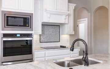 photo of a kitchen showing oven, stove, and sink